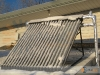 Snow And Ice Covered SunMaxx Evacuated Tube Solar Collector In Upstate NY