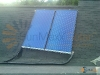 Home With Flat Plate Solar Collectors Hot Water System